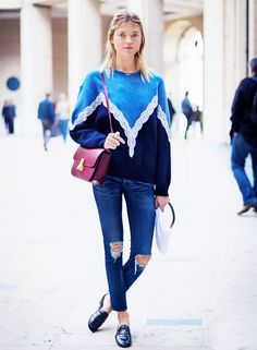 Bright blue sweater, ripped jeans and patent leather loafers