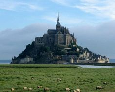 castles in normandy | Normandy castle, Aka tangled castle;) This Is Chateau Mont St Michel.  The entire castle (an old monastery) is on an island, with a causeway that you can see in the foreground.