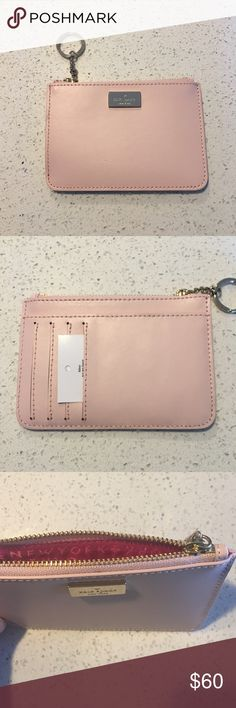 ♠️ kate spade keychain wallet Brand New  kate spade arbour hill bitsy in pink blush/ sweetheart pink inside! This beautiful small keychain coin purse/wallet is perfect for the girl on the go. Features include 14 karat plated signature kate spade logo plate, gold plated key ring, zippered closed pouch, 4 card slots on the back along with open back pocket. It is also new with tags! Please  Trades and  PayPal! Happy shopping poshers ☺️ kate spade Bags Wallets