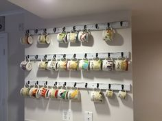 Our collection of Starbucks mugs on the new rack we just made.