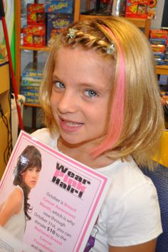Pink hair represents hope for breast cancer survivors and patients
