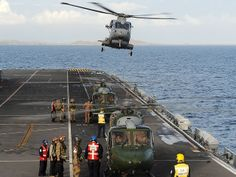 (26/11/13) aircraft from HMS Illustrious began transporting personnel,equipment & aid to shore to assist in Humanitarian Relief Operations being conducted around islands of Philippines.Onboard Merlin Helicopter from 829 Naval Air Squadron,3 Lynx of 659 Squadron Army Air Corps & 3 Sea King from 845 Naval Air Squadron.Ship currently carries Sea King MK4,Merlin HM1 & Lynx MK 7 helicopters.Also has 42 Commando Royal Marines embarked alongside her crew of approximately 650 men & women.