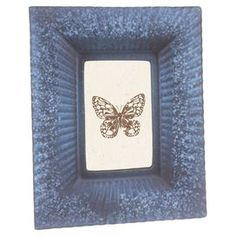 """Glass picture frame with starburst motif.   Product: Picture frameConstruction Material: GlassColor: BlueFeatures: Holds one 4"""" x 6"""" photoDimensions: 10.5"""" H x 8.5"""" W"""