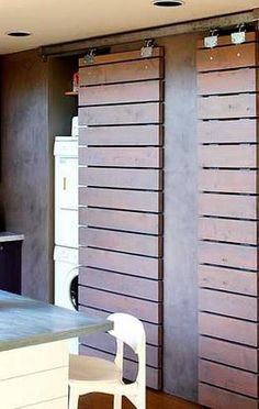 """I have a wall of shelves/cubbie area's in our converted garage area. In my effort to turn this area into a game room I am wondering if I could use old pallet boards to create doors like this that would move along a track. When closed they would close off the """"full"""" shelves/cubbies and make the room a bit more 'homey' looking ?"""