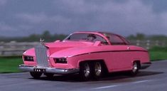 Thunderbirds - FAB 1 pink, six-wheeled Rolls Royce owned by International Rescue agent Lady Penelope Creighton-Ward and driven by her butler, Parker. Christopher Eccleston, Radios, Thunderbird Car, Thunderbirds Are Go, Cult, Film D'animation, Rolls Royce, Concept Cars, Cool Cars
