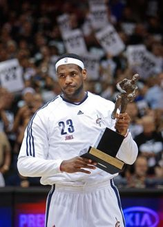Cleveland Cavaliers' LeBron James holds the 2009-2010 MVP trophy during a presentation before Game 2 against the Boston Celtics in the second round of an NBA basketball playoff series Monday, May 3, 2010, in Cleveland. (AP Photo/Mark Duncan)