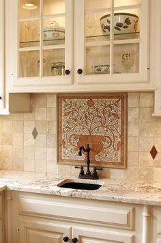 Backsplash with mosaic, limestone, and Walker Zanger diamond dots.  www.jsbrowncompany.com