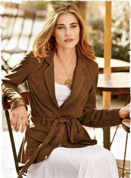 A legend of a jacket, crafted of buttery soft, fawn-hued suede. The supple, blouse-like silhouette belts at the waist, with single button closure and flirty draped peplum in back. Flap pockets; lined sleeves.
