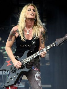 ★ Lita Ford ☆  wallpaper with a guitar player and a concert in The Rock Guitar Legends Club