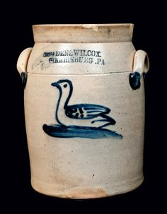 "Price Realized: $ 3,450.00 | Central PA Stoneware)Rare One-Gallon Stoneware Jar with Cobalt Swan Decoration, Stamped ""COWDEN & WILCOX / HARRISBURG, PA,"" circa 1865, cylindrical jar with tooled shoulder, tall collar, and applied lug handles, decorated with a cobalt design of a swan with spotted and striped wing, swimming on stylized water. This desirable Cowden & Wilcox design is difficult-to-find on pieces of"