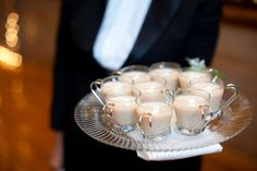During christmas coquito is a traditional hispanic drink. The way this is being served is a great wedding idea for the christmas season.