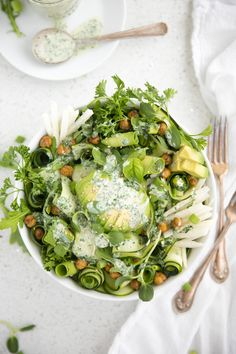 zucchini avocado salad with garlic herb dressing and roasted chickpeas