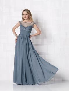 Beautiful evening gown with a lace overlay and fitted belt ...
