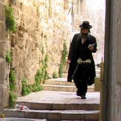 images of the old city in jerusalem | Chasidic Jew studying and walking in Jersualem's Old City