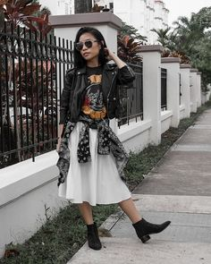 When it comes to looking nonchalantly badass, a leather jacket and a beat-up band tee will never let you down. Pair them with a flowy skirt rather than skinny jeans for a femme twist on the classic look.