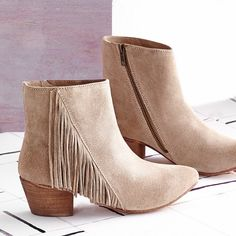 Suede and fringe are back in a major way. Step into the trend with a pair of booties.