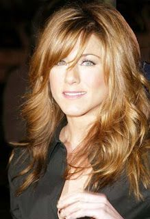 Jennifer Aniston long layers with bangs.  Her hair is always gorgeous.