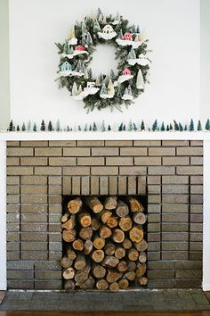 Love the village wreath & all the bottle brushes lined up across the mantle. Living With Kids: Alison Faulkner