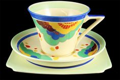 'Gaylee' one of the most striking of the Doulton Art Deco-style shapes & patterns. The earthenware cup has an outward flare & a sharp '7-shaped' handle.