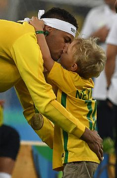 Brazil's forward Neymar celebrates with his son after the Rio 2016 Olympic Games…