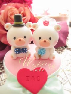 LOVE ANGELS Wedding Cake Topper-love polar bear by kikuike on Etsy. They have the most adorable cake toppers!!