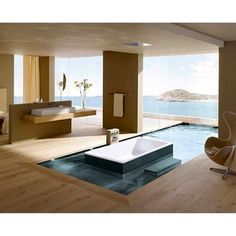 This is amazing, its a bathtub inside a pool that is inside a bathroom that has a balcony with a view to the ocean. Picture by @earthofluxury Be rich and famous! Live the life of your choice. Check out billionaireclubhouse on Instagram!
