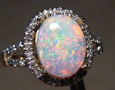 I wish I could find the other wedding band with this color opal. I like the even small flecks of color with it mostly white/pinks and light blues.  BestOpalRings.com