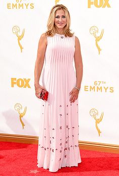 Edie Falco in a pleated Prada dress accented by red jewels at the 2015 Emmy Awards.  Read more: http://www.usmagazine.com/celebrity-style/pictures/emmy-awards-2015-red-carpet-fashion-2015189/47280#ixzz3maHMKYdp  Follow us: @usweekly on Twitter | usweekly on Facebook