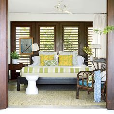 A Puerto Rico hilltop home boasts bedrooms that act like sleeping porches, situated so ocean breezes can flow in and out through screened louvered doors.