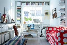 Love the bookcases over the window!!! Bebe'!!! Great display and storage!!!
