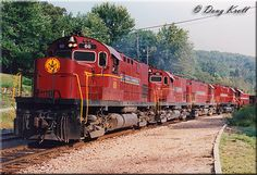 A quartet of Arkansas & Missouri C420s along with a T6 run southbound with their freight as the train approaches Winslow Tunnel on September 18, 1992.