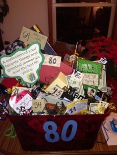 80th Birthday Basket for my Grandpa....Filled with his favorite things and some fun memories over the last 80 years! Candy,coffee,lotto tickets,popcorn,books, pictures of kids, grand kids, great grandson, and lots more!!