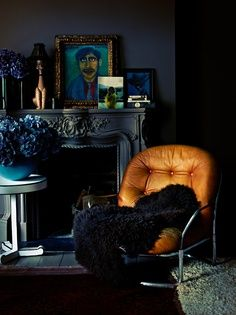 Black ornate fireplace and great chair