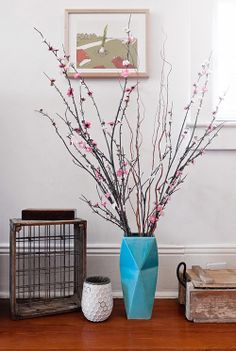 I like the vase and cherry blossom branches. Shawn would like the old crates. Vase With Branches, Origami, My Living Room, Home Decor Furniture, Decoration, Color Splash, Planting Flowers, Sweet Home, House Design