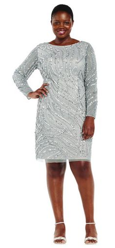 What's not to love about this long sleeve party dress? Featuring intricately swirled beading, a circle neckline, long sleeves, and a sheer extended hem at the skirt, this beaded sheath dress stuns no matter the season. This classic beaded dress is easily styled with a matching metallic high heel and clutch.