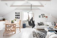Light attic apartment with hammock