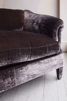 Fluffy Dark Purple Sofa standing out against the lighter surroundings
