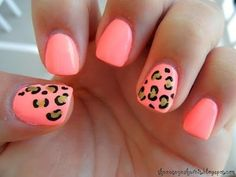 Bright coral colored cheetah nails