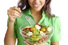 woman eating salad healthy vegetables