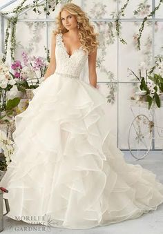 Lace and ruffles! #weddingdress #morilee