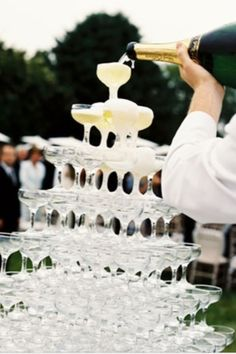 Love this champagne tower! Could place it in the middle of cocktail hour.