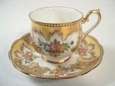 Beautiful hand painted tea cup and saucer made by Royal Albert, England. Model: Royalty Cup shape: Hampton c.1930 + The tea cup is 2 5/8 high and the saucer is 5 1/2 diameter The rims, the base and the thumbrest are gilt. It is in a very good condition, no chips, no hairline and no