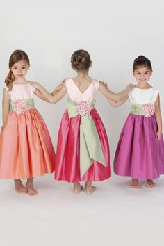 Taffeta flower girl dress with sash and handmade silk flower.  V-back.  Available in various colors. Girls sizes 2T - 12.  Special sizing options available.
