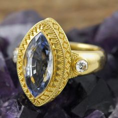 Solid genuine 22K yellow GOLD ring set with a Blue Sapphire gemstone, Diamonds and decorated with Bali granulation work