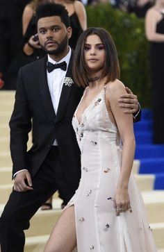The Weeknd and Selena Gomez on the steps of the Met. Picture: AP
