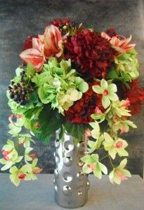 Faux orchids in a full arrangement - Studio 100