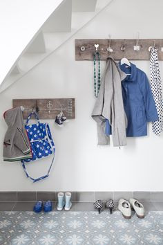 DIY Coat rack - I like how the knobs and hooks don't match  (Portuguese tiles by sabine burkunk - tiles from www.tegelaer.nl)