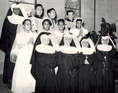 Sister Marilyn on Mission Sunday in the late 1940s at Holy Name of Mary in Chicago, IL with little OSPs, Brides of Christ, seminarians and priests.