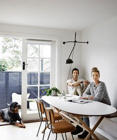 "Homeowners Rhiannon Farmer and Matt Orr, who run interior design and building company [Design Orr Build](http://www.designorrbuild.com.au/|target=""_blank""), sit in their newly created dining nook with French doors leading to the new back deck. The dining chairs were found on the street. Dining **table** from [Ikea](http://www.ikea.com.au/