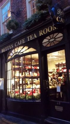 Betty's, the best tea house in Glouchestershire. We loved it and made a point of going there.Scrumptious teas served there, and I hope to go back one day! Shop Fronts, Christmas Shopping, Great Britain, Afternoon Tea, Best Tea, Tea Time, Countryside, Tea Pots, Places To Go